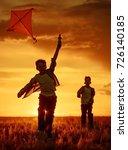 children launch a kite in the... | Shutterstock . vector #726140185