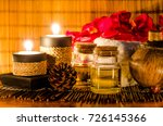 Small photo of Body washing aroma gel with beautify red orchid and soft white towel with a sweet couple of vintage candlestick, over oriental style woven bamboo sheet wallpaper, for health care and spa concept