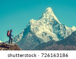 hiker reaches the summit of... | Shutterstock . vector #726163186