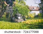 mowing the grass with a lawn... | Shutterstock . vector #726177088