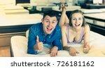 man and woman choosing mattress ... | Shutterstock . vector #726181162