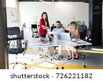 three business people in the...   Shutterstock . vector #726221182