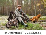 hunter with dogs during the...   Shutterstock . vector #726232666