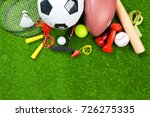 various sport tools on grass | Shutterstock . vector #726275335