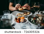 eating bread or focaccia served ... | Shutterstock . vector #726305326