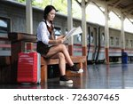 traveler woman sitting on a... | Shutterstock . vector #726307465