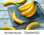 yummy bananas on wooden... | Shutterstock . vector #726404332