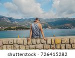 the man is sitting on the dock... | Shutterstock . vector #726415282