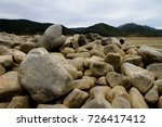 round stones. worn by the sea. | Shutterstock . vector #726417412