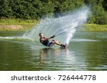 Young Male Athlete Glides On...