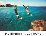 cliff jumping into the ocean ... | Shutterstock . vector #726449842