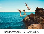 cliff jumping into the ocean ... | Shutterstock . vector #726449872