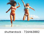 happy girls jumping into the... | Shutterstock . vector #726463882