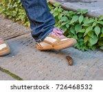 Foot Closeup Of A Pedestrian...
