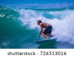 riding the waves. costa rica ... | Shutterstock . vector #726513016