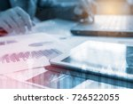 tablet with business graphs and ... | Shutterstock . vector #726522055