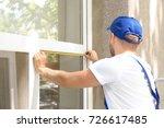 man measuring window prior to... | Shutterstock . vector #726617485