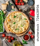 pizza four cheeses on the table | Shutterstock . vector #726628936