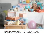 Stock photo gifts for baby shower on stool indoors 726646642