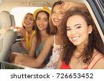 beautiful young women in car | Shutterstock . vector #726653452