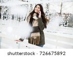 smiling young woman using phone ... | Shutterstock . vector #726675892