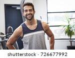 happy dude in a vest in gym ... | Shutterstock . vector #726677992