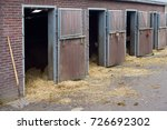 mucking out the stables at the... | Shutterstock . vector #726692302