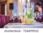 empty glasses set in restaurant.... | Shutterstock . vector #726699022