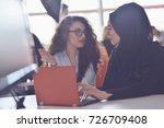 two muslim business woman... | Shutterstock . vector #726709408