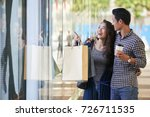 pretty young woman pointing ti... | Shutterstock . vector #726711535