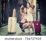 smiling travelers woman and... | Shutterstock . vector #726727435