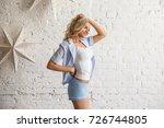 beautiful blonde girl in home... | Shutterstock . vector #726744805