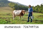 a farmer breeds and cows his... | Shutterstock . vector #726749716