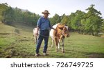 a farmer breeds and cows his... | Shutterstock . vector #726749725