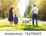 happy family with dog walking... | Shutterstock . vector #726758425