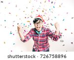 Small photo of Joyful Party Concept - One Asian People Having Fun and Enjoy with Colorful Confetti in Surprise and Excite Emotion