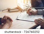 doctor hand holding pen writing ...   Shutterstock . vector #726760252