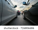cars on city street in traffic... | Shutterstock . vector #726806686