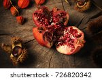 pomegranate and chestnuts | Shutterstock . vector #726820342