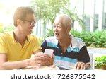 asian senior man and son using... | Shutterstock . vector #726875542