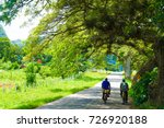 two men cycling down road in... | Shutterstock . vector #726920188