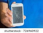 man holding a broken smart...   Shutterstock . vector #726960922