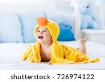 happy laughing baby wearing... | Shutterstock . vector #726974122