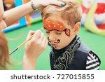 master making aqua makeup on... | Shutterstock . vector #727015855