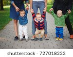 mothers holding sons by hand | Shutterstock . vector #727018222