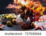watering can with autumn leaves ... | Shutterstock . vector #727030066