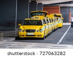 row of yellow taxis in madeira... | Shutterstock . vector #727063282