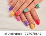 multicolored manicure close up. ... | Shutterstock . vector #727075642