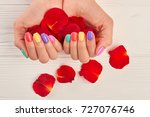 Stock photo rose petals in manicured hands female hands with summer manicure holding rose petals close up 727076746