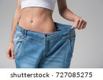 slim girl wearing oversized... | Shutterstock . vector #727085275